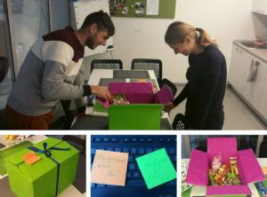 Kolegos tikrina dovanų dėžutės turinį